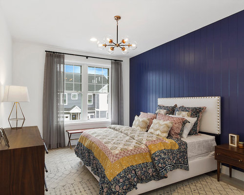 Example Of A Transitional Bedroom Design In New York With Blue Walls