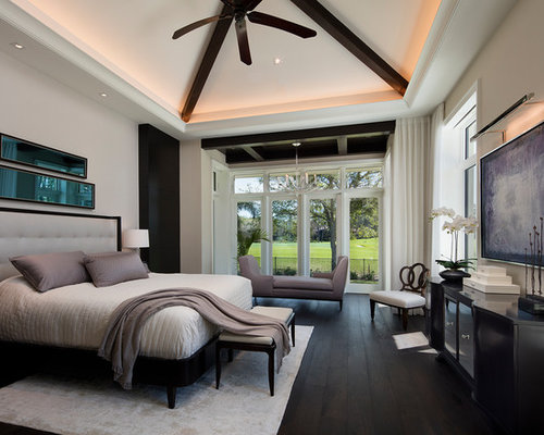 Trendy Dark Wood Floor And Black Bedroom Photo In Other With Gray Walls