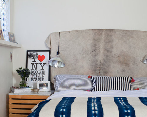 Example Of An Eclectic Bedroom Design With White Walls Save Photo Cowhide Headboard