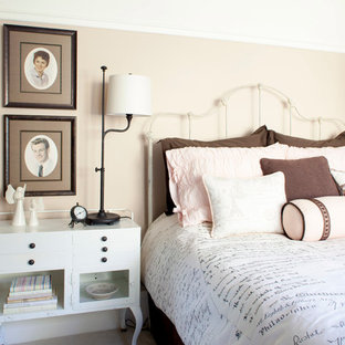 Example of a mid-sized cottage chic guest carpeted bedroom design in Portland with pink walls