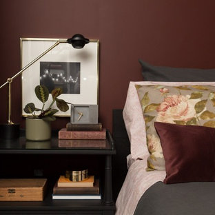 Small eclectic master bedroom photo in Toronto with red walls