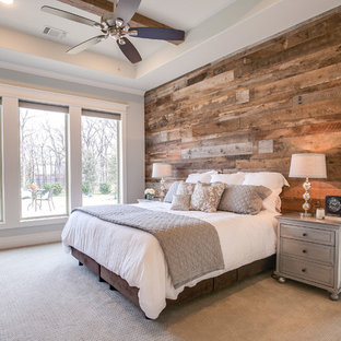 Example of a mid-sized farmhouse master carpeted and brown floor bedroom design in Dallas with gray walls
