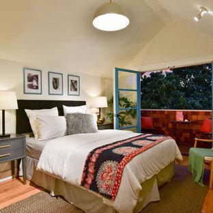 Bedroom - transitional medium tone wood floor, brown floor and vaulted ceiling bedroom idea in San Francisco with beige walls