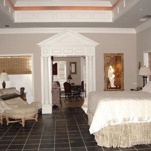 На фото: хозяйская спальня среднего размера в классическом стиле с белыми стенами, полом из сланца и черным полом без камина с