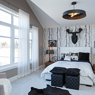 Contemporary bedroom in Toronto with carpet, grey walls and no fireplace.