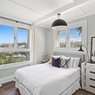 Inspiration for a mid-sized transitional master bedroom in Sydney with dark hardwood floors, brown floor and grey walls.