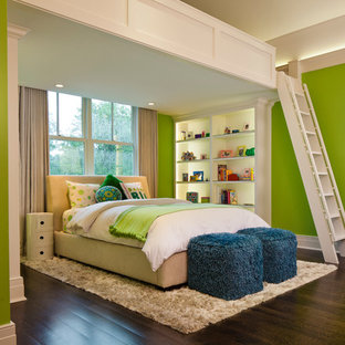 Photo of a large beach style mezzanine bedroom in Chicago with green walls and medium hardwood flooring.