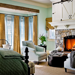 Elegant bedroom photo in New York with a stone fireplace and a standard fireplace
