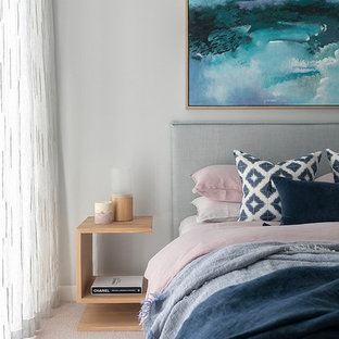 Photo of a contemporary bedroom in Sydney with grey walls, carpet and beige floor.