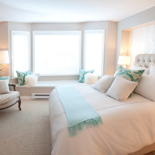 Trendy carpeted bedroom photo in Vancouver with beige walls