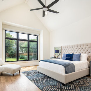 Inspiration for a transitional medium tone wood floor and brown floor bedroom remodel in Dallas with white walls