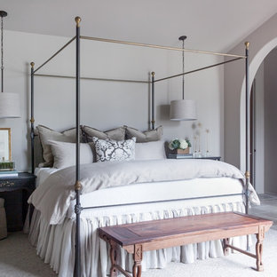 Example of a large transitional master gray floor and limestone floor bedroom design in Nashville with beige walls and no fireplace