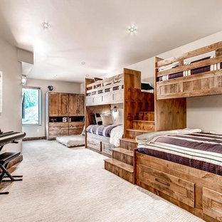 Bedroom - large rustic guest carpeted and beige floor bedroom idea in Denver with gray walls and no fireplace