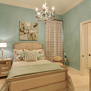 Example of a mid-sized classic guest travertine floor and beige floor bedroom design in New Orleans with blue walls and no fireplace