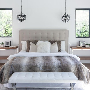 Inspiration for a medium sized classic guest bedroom in Los Angeles with white walls, laminate floors and beige floors.