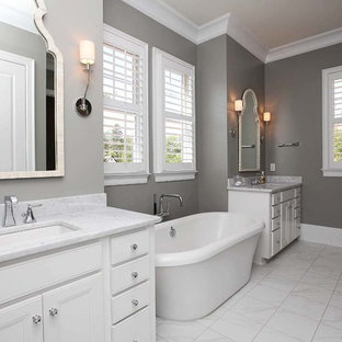Example of a large classic master marble floor bedroom design in Charlotte with gray walls