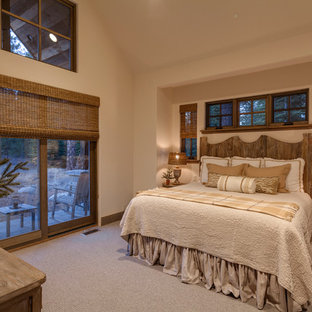 Example of a mountain style carpeted and gray floor bedroom design in Other with beige walls