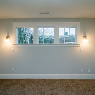 Inspiration for a mid-sized arts and crafts master bedroom in Portland with grey walls and carpet.