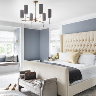 Example of a large transitional carpeted and beige floor bedroom design in New York with gray walls