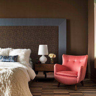 Example of a trendy carpeted bedroom design in New York with brown walls