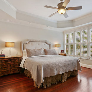 Example of a mid-sized classic master dark wood floor and red floor bedroom design in Atlanta with white walls and no fireplace