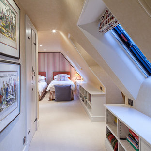 Bedroom - traditional carpeted bedroom idea in London with beige walls