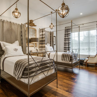 Example of a tuscan dark wood floor bedroom design in Dallas with white walls