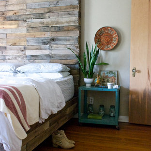 Eclectic medium tone wood floor bedroom photo in Dallas with gray walls