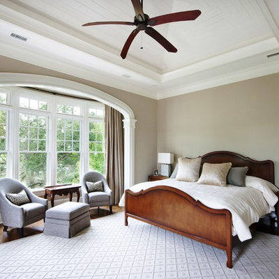 Inspiration for a timeless bedroom remodel in Charleston with beige walls
