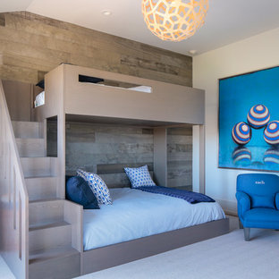 This is an example of a mid-sized contemporary loft-style bedroom in New York with multi-coloured walls and carpet.