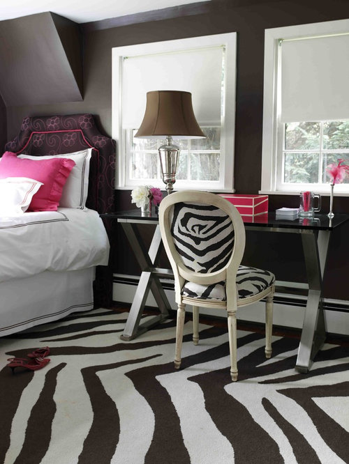 Example Of A Trendy Bedroom Design In New York With Black Walls