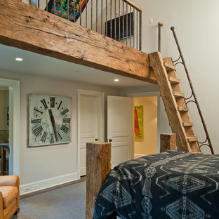 Design ideas for a large country loft-style bedroom in New York with white walls, dark hardwood floors, no fireplace and brown floor.