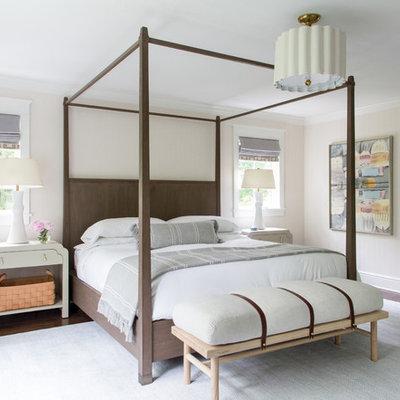 Transitional dark wood floor and brown floor bedroom photo in New York with beige walls
