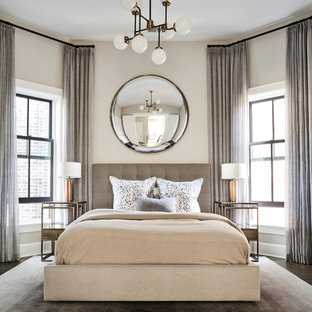 Inspiration for a mid-sized transitional guest dark wood floor and beige floor bedroom remodel in Chicago with beige walls and no fireplace