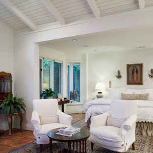 Design ideas for a traditional bedroom in Dallas with terra-cotta floors.