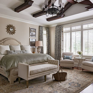 Inspiration for a timeless master medium tone wood floor bedroom remodel in Charlotte with beige walls