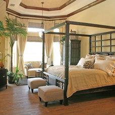 Tropical Bedroom by de'Shea Interiors, Inc.