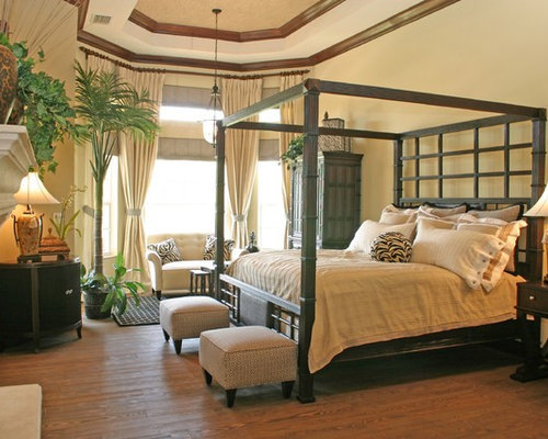 Example Of An Island Style Master Medium Tone Wood Floor Bedroom Design In  Miami With Beige