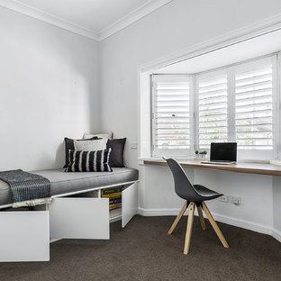 Inspiration for a contemporary bedroom in Sydney with grey walls, carpet, no fireplace and black floor.