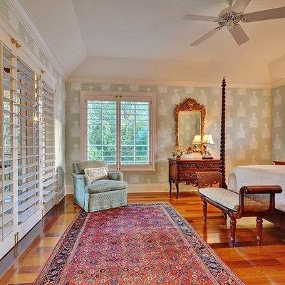 Bedroom - tropical medium tone wood floor bedroom idea in Miami with multicolored walls