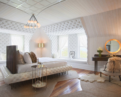 Inspiration For A Contemporary Medium Tone Wood Floor Bedroom Remodel In London