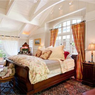 Example of a classic medium tone wood floor bedroom design in Seattle with beige walls