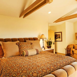 Design ideas for a mid-sized traditional master bedroom in Seattle with beige walls, carpet, no fireplace and yellow floor.