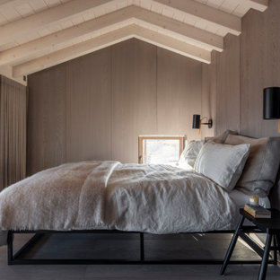 Inspiration for a beach style bedroom in Essex with brown walls, dark hardwood flooring, brown floors, exposed beams, a vaulted ceiling, a wood ceiling and wood walls.