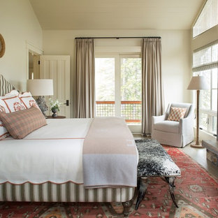 Bedroom - rustic master bedroom idea in Seattle with beige walls, a standard fireplace and a stone fireplace