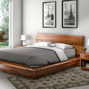 На фото: хозяйская спальня среднего размера в стиле рустика с двусторонним камином с