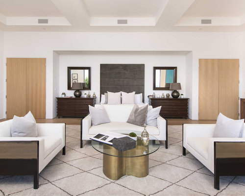 contemporary master bedroom idea in los angeles with white walls light hardwood floors and beige - The Best Master Bedroom Design