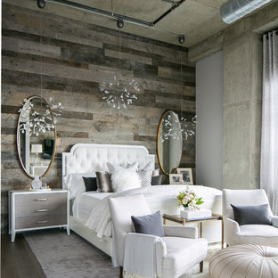 Example of a large urban master medium tone wood floor and gray floor bedroom design in Denver with gray walls