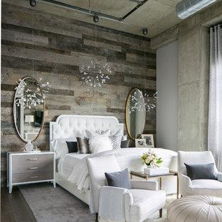 На фото: большая хозяйская спальня в стиле лофт с серыми стенами, паркетным полом среднего тона и серым полом без камина с