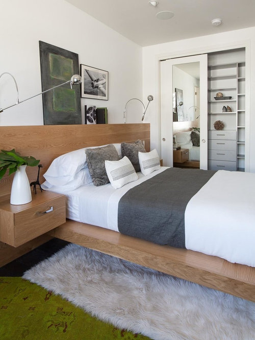 Example of a trendy bedroom design in Denver with white walls